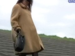 Hot Jap slut releases a golden shower in the open air