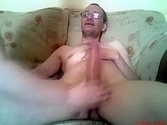Giving a freaky deepthroat to my aged husband on the couch