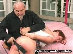 Bullwhip spanking for a cute redhead babe