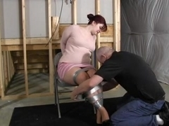 Chubby redhead gets hogtied tightly
