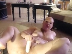 Chubby webcam blonde sucks a dildo before poking it in her twat