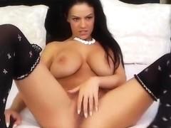 Busty brunette Raisabella caresses herself