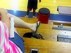 Blonde lady dangling flip flops 2