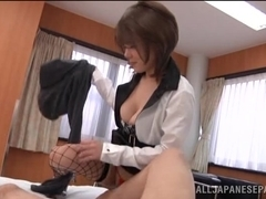 Hot Asian milf in sexy fishnets gets a titty fucking