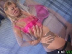 Big titted hottie Trina Michaels sticks a huge saugsage between her boobs