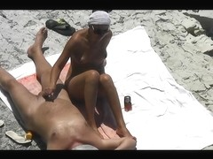 Now girlfriend masturbate him and helped cum on the beach