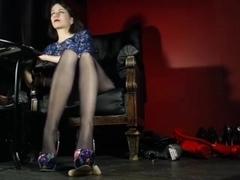 Mistress Hellena trampling with hosed feet on....