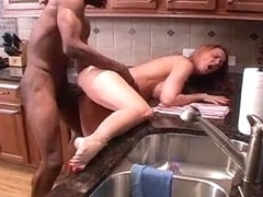hubby films wifey taking big ebon ding-dong in kitchen