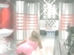 Busty blonde bimbo shows her upskirt panties in TV show
