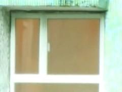 A horny voyeur loves filming hot girls thru the window.