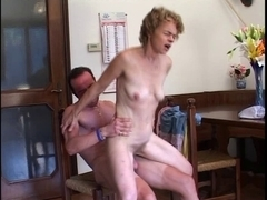 Blonde MILF is fucked in her mature pussy on the chair
