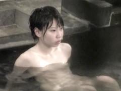 Gorgeous Asian bimbo facing hidden cam and showing nude back nri010 00