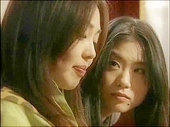 Aged Asian lesbian fucking her younger gf in her pussy