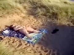 horny slut at beach masturbating for voyeurs