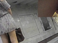 Adorable dame tries to hide thong in best upskirt ever