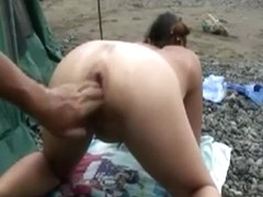 She wants to get her asshole fisted on the public beach