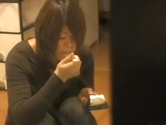 Asian doll licks the dildo and sticks it into the nub
