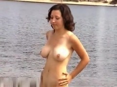 Large milk sacks stripped on the nudist beach