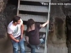 Voyeur captures a girl riding her bf on the stairs in public