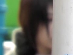 Shy Japanese trick playing with her phone during sharking attack