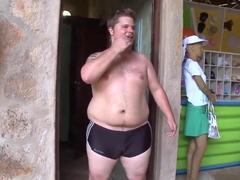 Two horny guys walking along Brazilian beach
