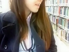 Riding red dildo on library