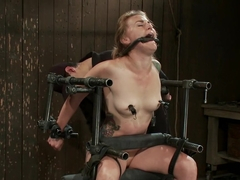 Bound in a custom metal bondage rig. Made to cum, she can't stop the orgasms that rip though her