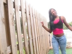 Young Ebony neighbor girl with plump and pert oiled butt