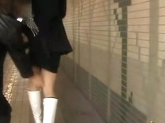 Asian babe has her panties pulled during street sharking.