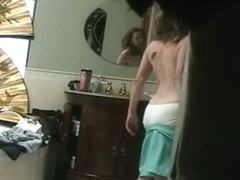 A chubby nude girl filmed by a spy camera.