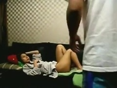 Young asian couple makes a sextape on the sofa