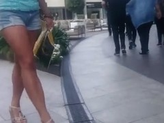 Candid hot mature in short jeans.