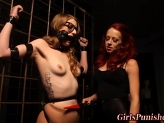 Lesbo sub on a leash spanked