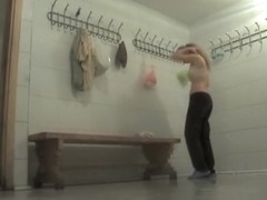 Naked brunette amateur is alone in a changing room