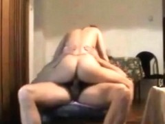 Hot blonde fucks an old man on a chair and swallows