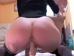 Girl in pantyhose fucking herself with a dildo