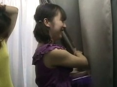 Asian chicks having fun with tits enhancer in changing room