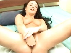 Luscious brunette with perky boobs has a guy pleasing her fiery pussy