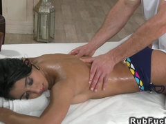 Tanned beauty fucks masseurs cock