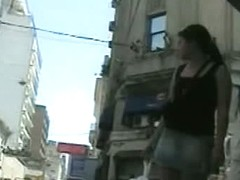 Candid street upskirt with sexy brunette in short skirt