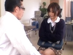 Cute Jap babe gets her pussy fingered during medical exam