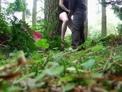 Horny couple fuck outside in the woods.