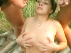 Busty brunette taking 2 army cocks outside