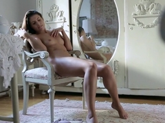 Enticing young brunette loses her panties and takes care of her needs