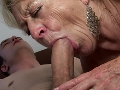 Busty blonde granny is always ready to take on a young man's big cock