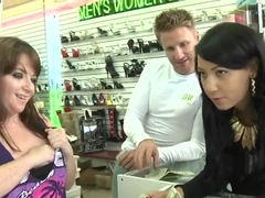 Hot babes are posing in the store for a stranger
