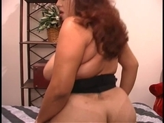 Curvy Lalin Girl rides vibrator on dresser